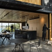 Simple shapes and a two-tone material palette, give architecture, furniture, house, interior design, table, black