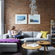 The lounge feels spacious, despite the small size chair, couch, furniture, home, interior design, living room, room, table, wall, brown