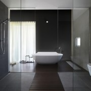 A double shower and toilet line the path architecture, bathroom, floor, interior design, plumbing fixture, product design, room, tile, black