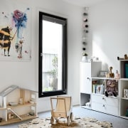 This nursery area is large, open and child-friendly furniture, home, interior design, living room, room, table, gray