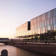 Municipal Offices and Train Station, Delft architecture, building, city, corporate headquarters, evening, facade, headquarters, metropolis, metropolitan area, mixed use, reflection, sky, structure, sunlight, water, waterway, white, black