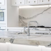 This new kitchen in a villa renovation features countertop, floor, flooring, interior design, kitchen, tap, tile, gray, white