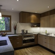 This large kitchen faces out to the leafy cabinetry, countertop, cuisine classique, interior design, kitchen, real estate, room, brown, gray