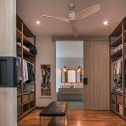 An expansive walk-in closet leads through to ensuite cabinetry, ceiling, floor, interior design, living room, room, brown, gray