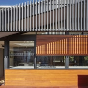 Slats add detail and throw interesting shadows architecture, building, commercial building, facade, mixed use, real estate, black