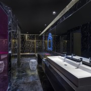 Purple draws the eye in this bathroom architecture, black