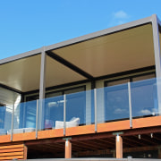 HomePlus Tauranga fitted three Bask louvre roofs for balcony, daylighting, facade, house, porch, real estate, roof, shade, siding, window, teal