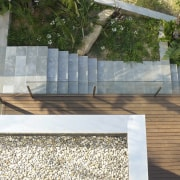 A layered view: You can see the garden, architecture, floor, outdoor structure, brown, white, gray