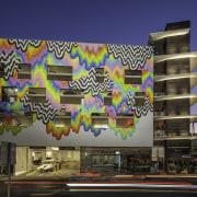 A mural by celebrated artist Jen Starck calls architecture, building, commercial building, condominium, facade, metropolis, metropolitan area, mixed use, mural, black, blue