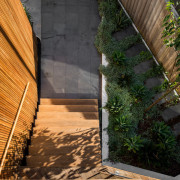 The steps up to the front entrance architecture, courtyard, facade, house, plant, property, wall, wood, brown