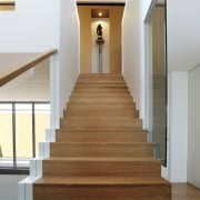 This simple staircase leads you up to the daylighting, floor, flooring, handrail, hardwood, home, house, interior design, laminate flooring, property, real estate, stairs, wood, wood flooring, gray, white, brown