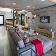 Concrete gives the ground floor a raw, industrial ceiling, floor, house, interior design, living room, loft, wall, gray