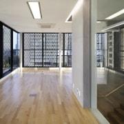 The 925 Building architecture, daylighting, estate, floor, flooring, handrail, hardwood, interior design, laminate flooring, real estate, wall, window, wood, wood flooring, gray