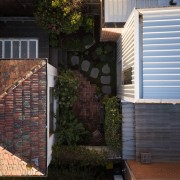 Another view of the courtyard backyard, brick, brickwork, facade, home, house, outdoor structure, property, real estate, residential area, roof, siding, wall, window, black
