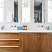 A wood vanity adds an element of colour bathroom, bathroom accessory, bathroom cabinet, cabinetry, countertop, interior design, kitchen, product design, room, sink, white