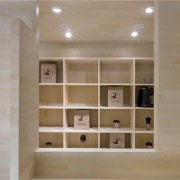 The wood creates a soft space bookcase, cabinetry, floor, flooring, furniture, hardwood, interior design, plywood, shelf, shelving, tile, wall, wood, wood flooring, gray, brown
