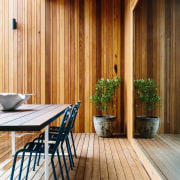 A timber deck stands apart from the walls architecture, deck, floor, hardwood, home, house, interior design, real estate, siding, wood, wood flooring, wood stain, brown, orange