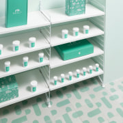 Sergio Mannino Studio designed this pharmacy to be furniture, product, product design, shelf, shelving, white