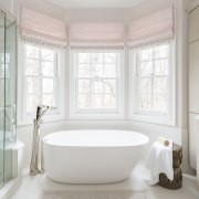 This low bathtub makes getting in and out bathroom, bathroom accessory, floor, home, interior design, plumbing fixture, room, window, gray