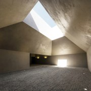This substantial room channels the light architecture, ceiling, concrete, daylighting, house, interior design, light, brown, black