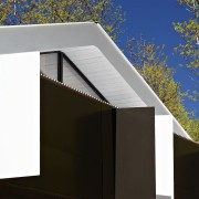 A white soffit balances out the dark panels architecture, building, daylighting, facade, home, house, product design, black