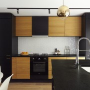 Contrasting elements come together in the kitchen cabinetry, countertop, cuisine classique, floor, interior design, kitchen, product design, black