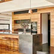 The kitchen sits at a different height to ceiling, countertop, floor, flooring, hardwood, interior design, kitchen, living room, table, wood, wood flooring, white, orange