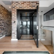 There are almost abstract forms throughout the central door, floor, flooring, interior design, gray