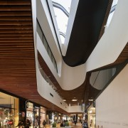 You can certainly tell you're standing in a architecture, building, ceiling, daylighting, mixed use, shopping mall, brown, gray