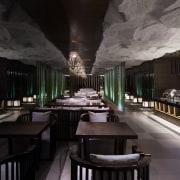 A rocky ceiling runs above the dining area interior design, restaurant, black, gray