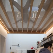 A net relaxing area makes for a fun architecture, beam, ceiling, daylighting, house, interior design, roof, wall, gray