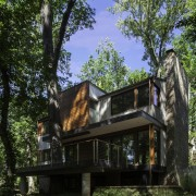 A view of the home from within the architecture, cottage, home, house, outdoor structure, property, real estate, tree, black, brown