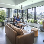 Natural surfaces and ample daylight are key features interior design, gray