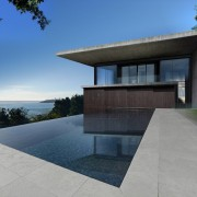 The infinity pool provides the best place to architecture, estate, facade, home, house, property, real estate, reflection, sky, gray, teal