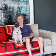 Two very happy home owners chair, couch, dog, fun, furniture, house, mammal, photograph, photography, red, room, sitting, vertebrate, gray