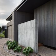 A secluded entryway is another private element architecture, building, facade, house, real estate, siding, gray, black
