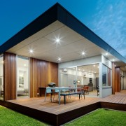 There are tidy lines separating the outdoor dining architecture, backyard, daylighting, estate, facade, home, house, interior design, property, real estate, roof