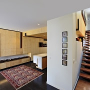 The stair sits ensconced in a passage to floor, flooring, interior design, real estate, gray