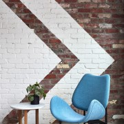 This feature wall has a pattern reflected in chair, floor, flooring, furniture, interior design, living room, table, wall, white