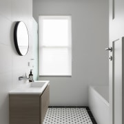 A floating vanity makes this space feel larger architecture, bathroom, bathroom accessory, bathroom cabinet, bathroom sink, daylighting, floor, home, interior design, plumbing fixture, product design, room, sink, tap, tile, gray, white