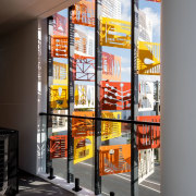 Mural-esque panels face out to the street glass, interior design, window, gray, black
