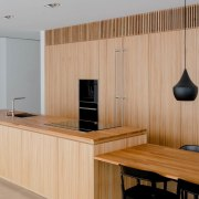 The use of wood draws the eye to floor, flooring, furniture, interior design, office, product design, wood, orange, gray