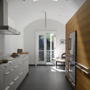 The arched ceiling in the kitchen also includes architecture, ceiling, countertop, daylighting, floor, flooring, interior design, kitchen, tile, gray