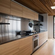 A large stainless steel splashback and rear benchtop cabinetry, countertop, cuisine classique, interior design, kitchen, real estate, brown