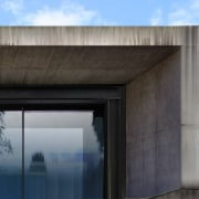 The concrete provides privacy and shelter architecture, building, daylighting, facade, sky, black