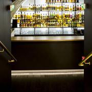 This new whiskey bar takes advantage of a bar, glass, interior design, black