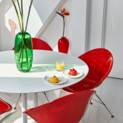 The various red elements thro chair, dining room, floristry, flower, flowerpot, furniture, interior design, product design, red, table, vase, gray