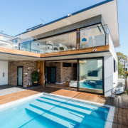 Looking up at the main living area architecture, daylighting, estate, facade, home, house, property, real estate, roof, swimming pool, window, teal, gray