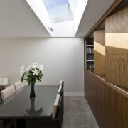 The dining area looks up to a large architecture, ceiling, daylighting, floor, house, interior design, lobby, gray