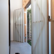 These large, barn-like doors open up to a architecture, door, floor, house, interior design, window, wood, gray, white